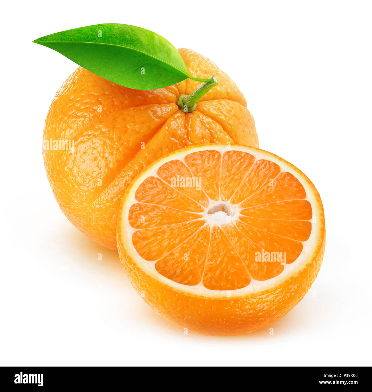 Isolated oranges. Cut fruits isolated on white background with clipping path - Stock Image