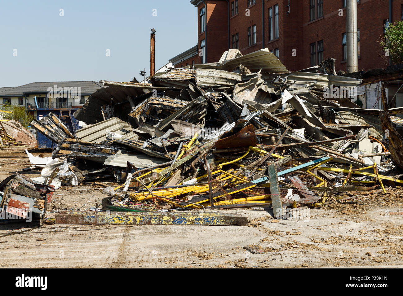 A large pile of scrap metal on a UK demolition site - Stock Image