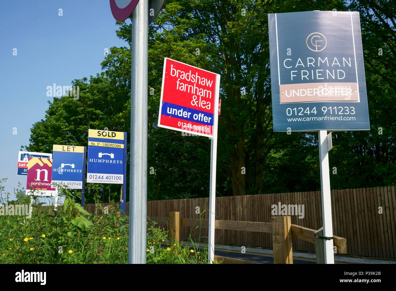 Estate agent boards showing Let, Sold and Under Offer - Stock Image