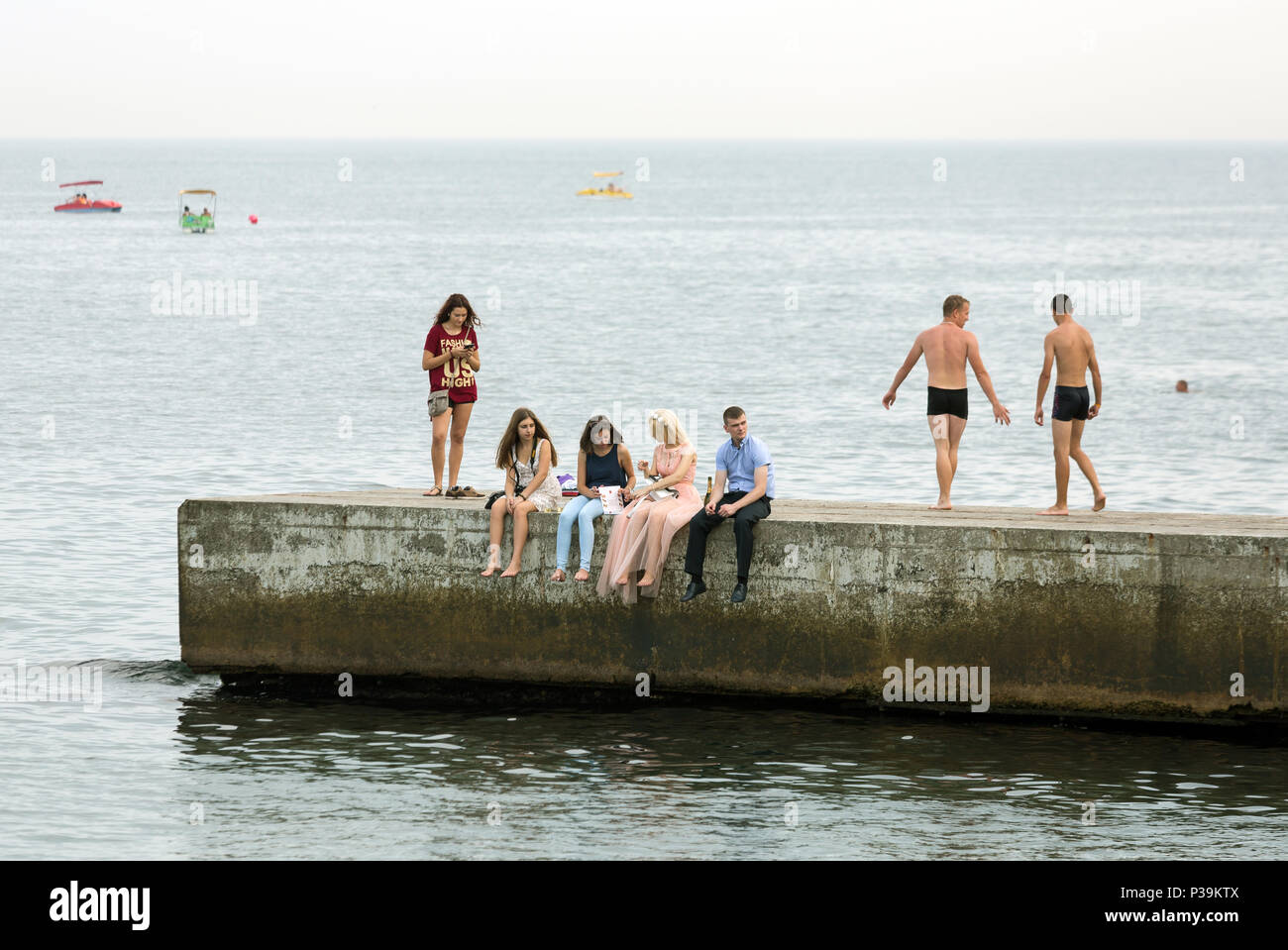 Odessa, Ukraine, people on a pier on the Black Sea - Stock Image