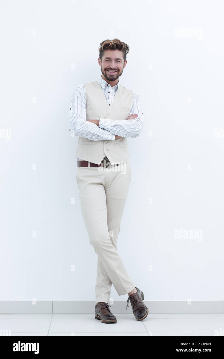 happy handsome stylish man with crossed hands - Stock Image