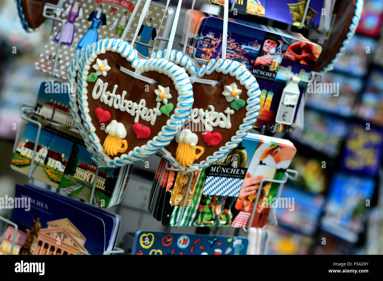Munich, Germany, gingerbread hearts and postcards at a souvenir shop - Stock Image