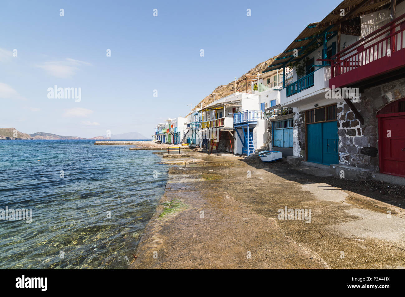 Colourfull old houses in fishermen town of Klima on Milos island, Greece. Sunny day, wide angle lens shot. - Stock Image