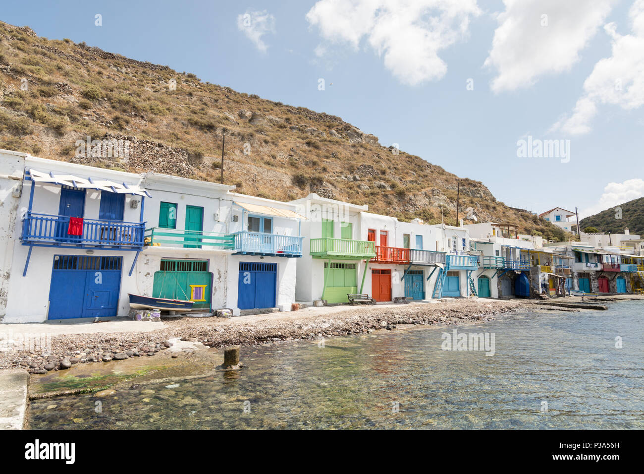 KLIMA, GREECE - MAY 2018: Colourfull old houses in fishermen town of Klima on Milos island, Greece. Sunny day, wide angle lens shot. - Stock Image