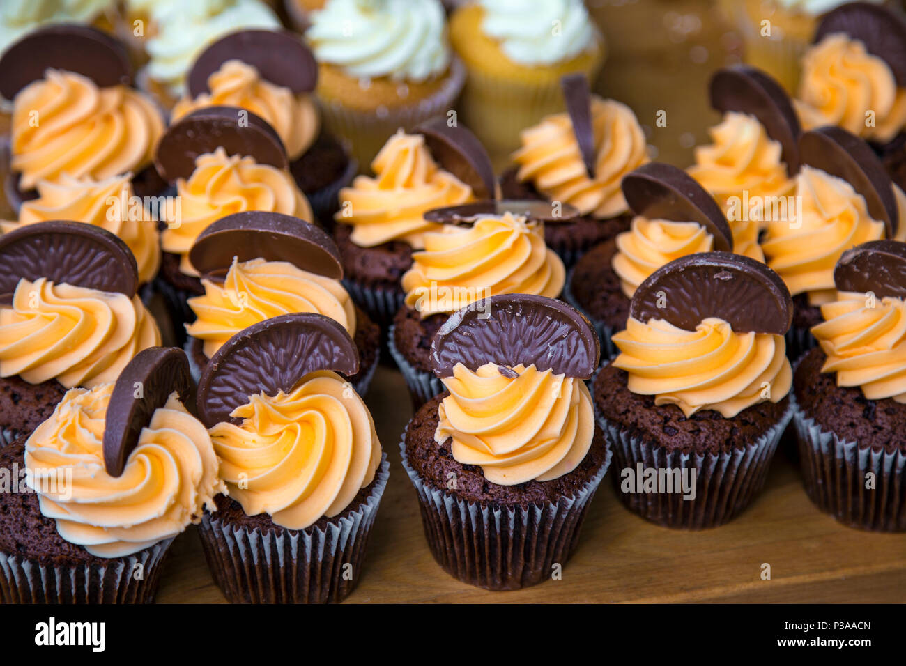 Chocolate orange cupcakes (Street Food Market at Piccadilly, Manchester, UK) - Stock Image