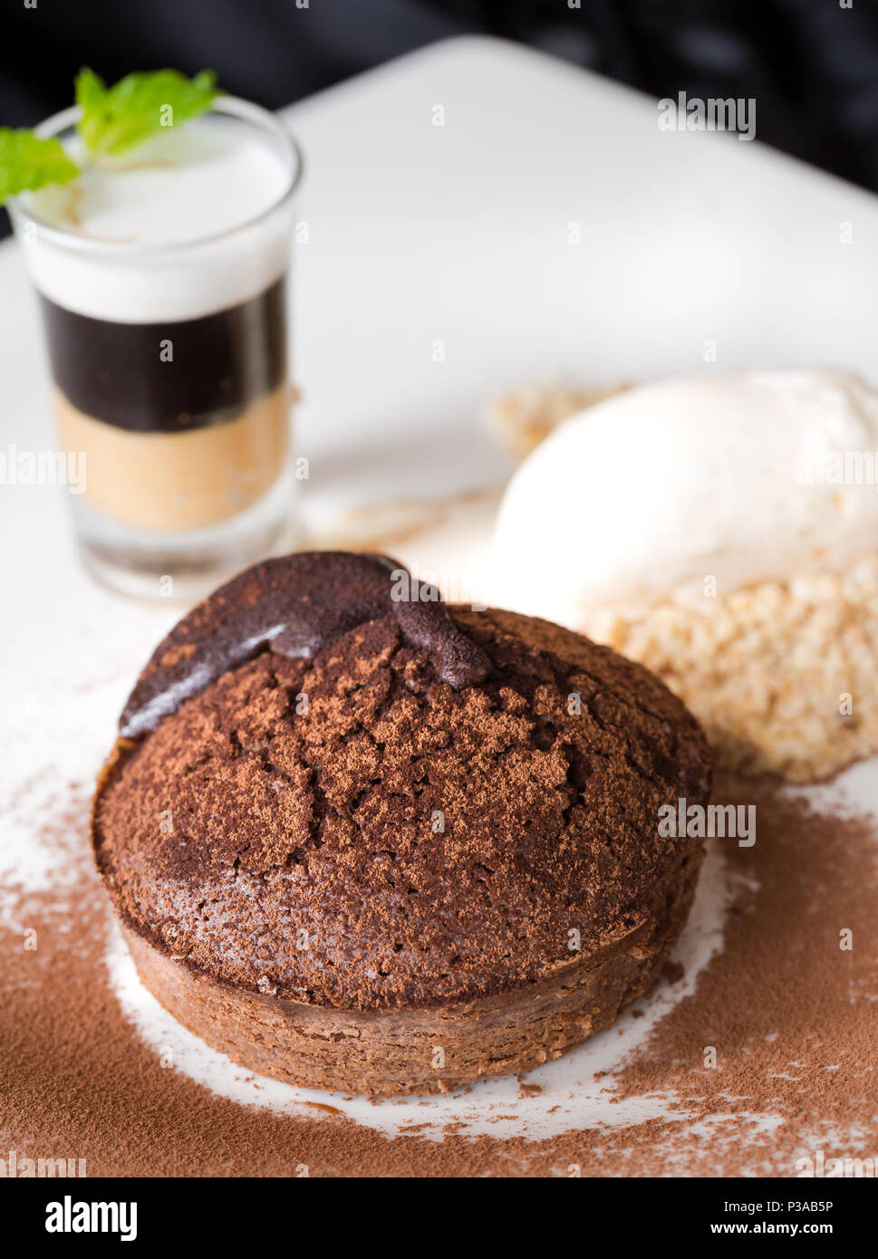 Chocolate lava cake or Molten Chocolate with fruit and vanilla ice cream Stock Photo