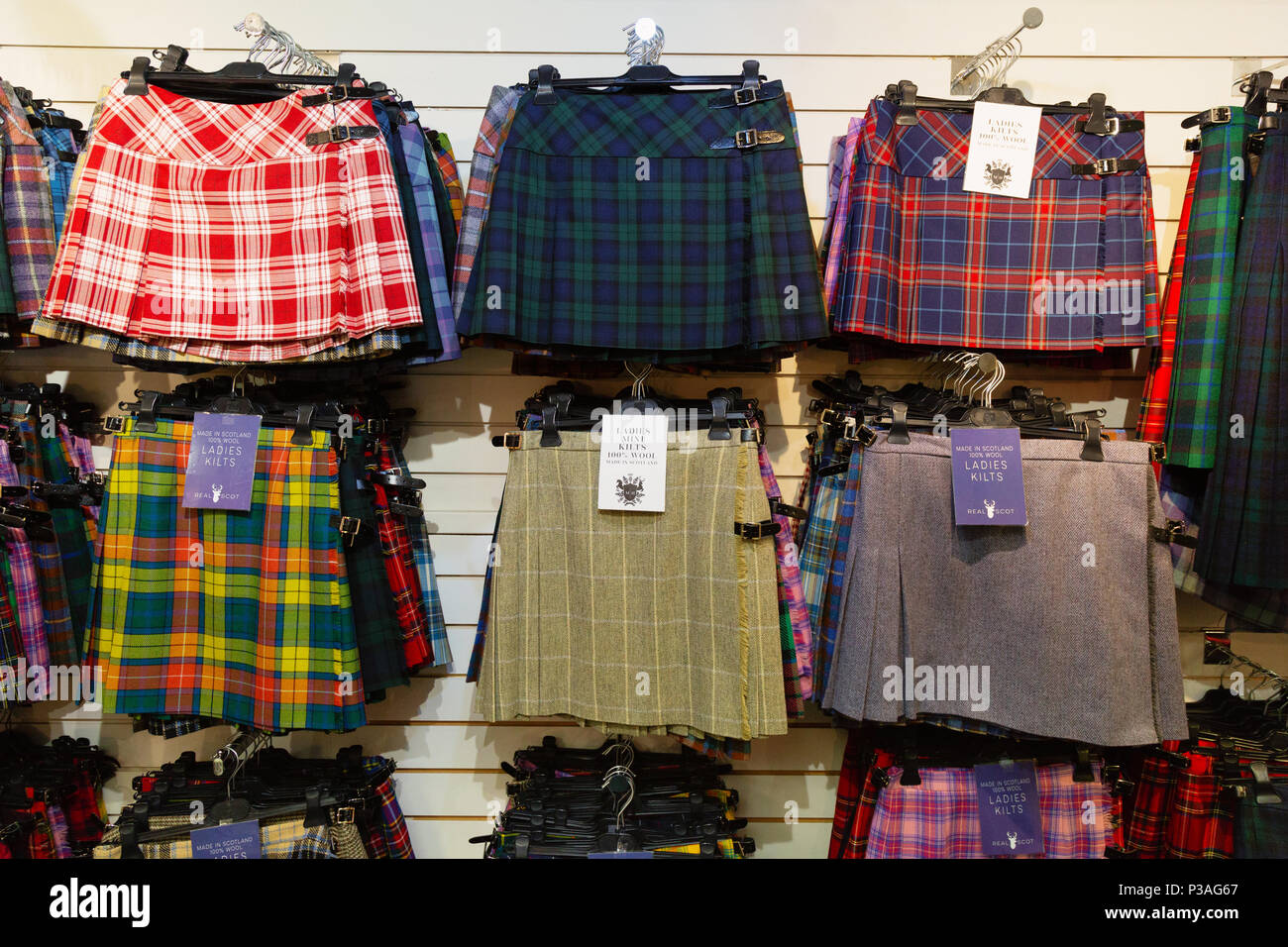 Tartan kilt skirts for women on sale in a kilt shop, Edinburgh, Scotland UK - Stock Image