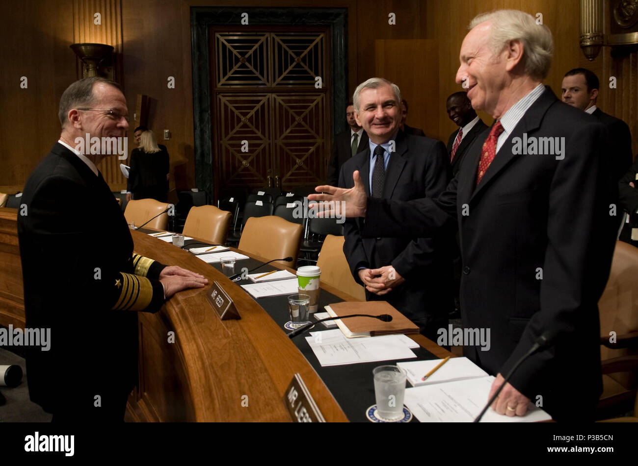 Chairman of the Joint Chiefs of Staff Navy Adm. Mike Mullen greets Sens. Jack Reed and Joe Lieberman prior to his reconfirmation hearing for his second term as chairman at the Dirksen Senate Office Building in Washington, D.C., Sept. 15, 2009. (DoD - Stock Image