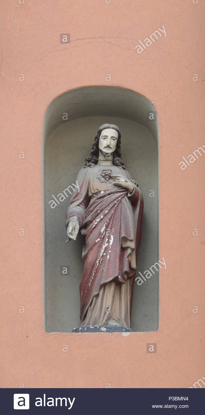 christ holy figure house wall - Stock Image