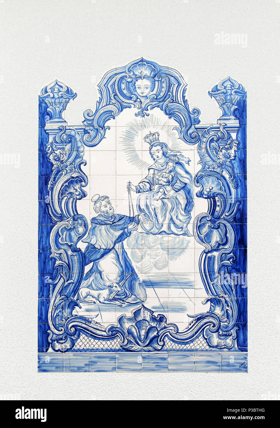 Traditional Portuguese blue and white painted tiles, called azulejos. - Stock Image
