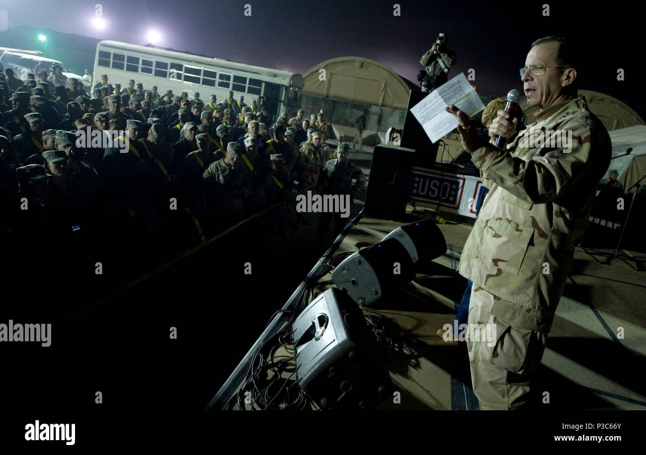 Chairman of the Joint Chiefs of Staff Navy Adm. Mike Mullen gives opening remarks to kickoff the 2009 USO Holiday Tour stop in Kandahar, Afghanistan, Dec. 17, 2009. Mullen and his wife Deborah are hosting the tour, which includes performances and appearances by former tennis player Anna Kournikova, comedian Dave Attell, tennis coach Nicholas Bollettieri and musician Billy Ray Cyrus. (DoD - Stock Image