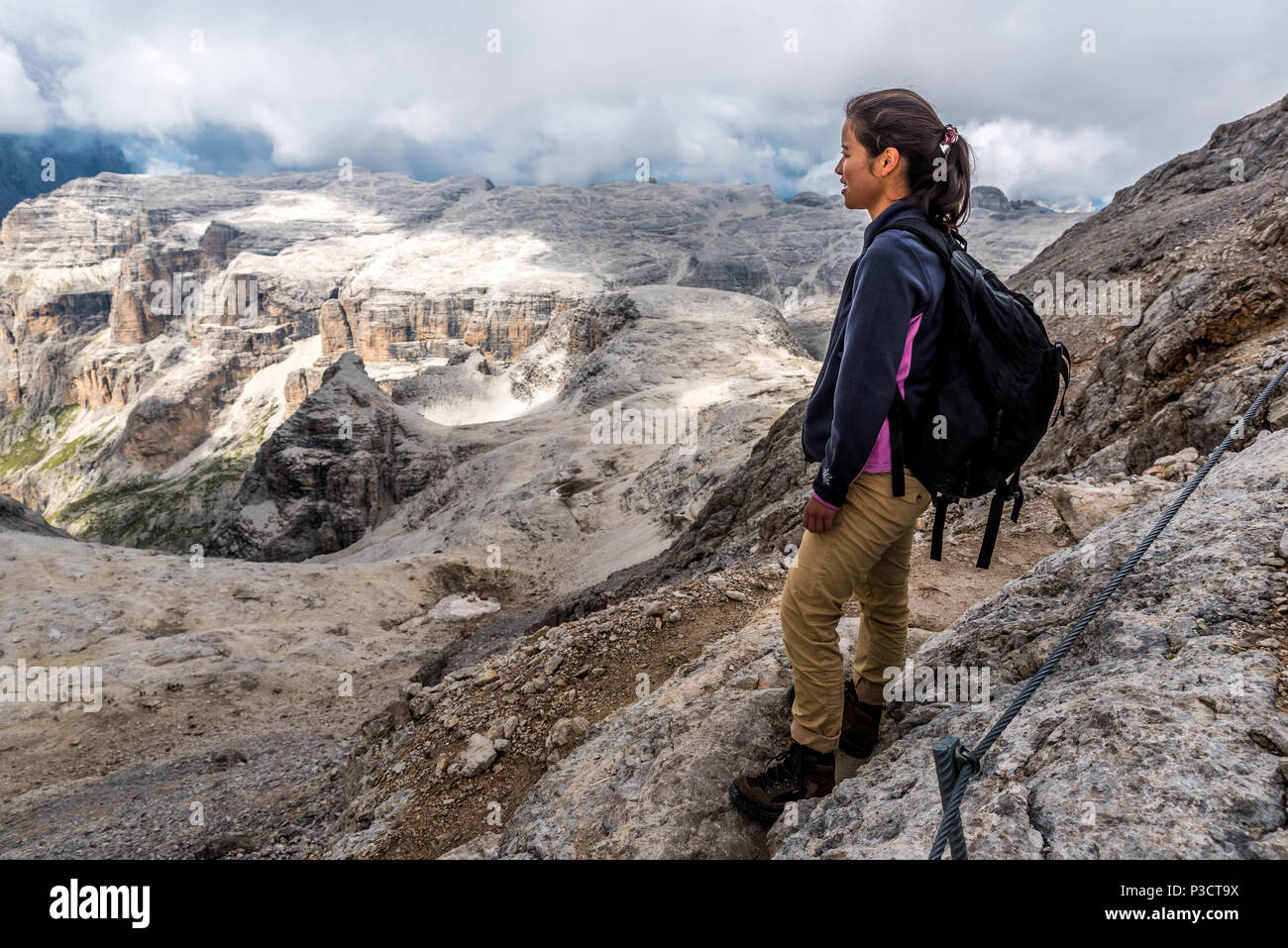 Hiker in Dolomites of Italy Stock Photo