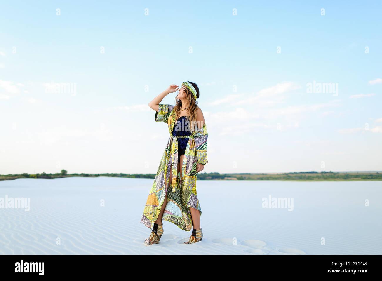 Caucasian female photo model with raised hand wearing black swim - Stock Image