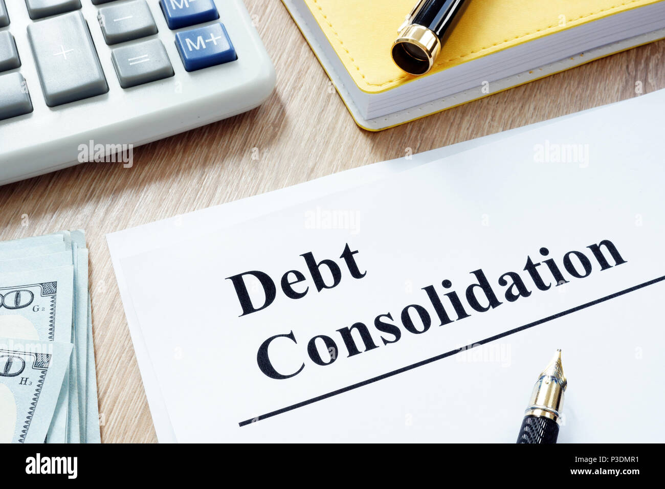Debt consolidation form and calculator and money. - Stock Image