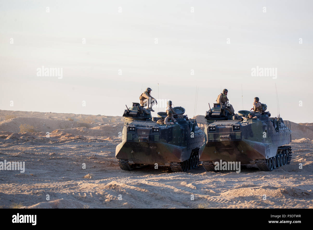 Marines with Delta Company, 4th Assault Amphibious Vehicle Battalion, 4th Marine Division, stage their assault amphibious vehicles for an obstacle clearing detachment practical application during Integrated Training Exercise 4-18, aboard Marine Corps Air Ground Combat Center Twentynine Palms, California, June 12, 2018. The OCD training was conducted to prepare Marines for the execution of a live-fire combined arms breach in which mechanized units will detonate a 1,000 pound mine clearing charge. Stock Photo