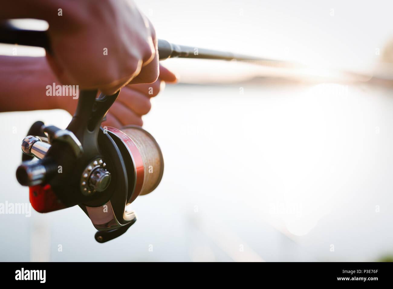 Fishing, hobby and recreational concept - fishermen - Stock Image