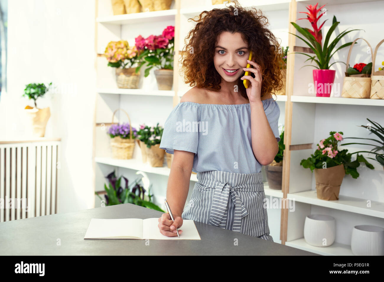 Nice professional businesswoman making a call - Stock Image