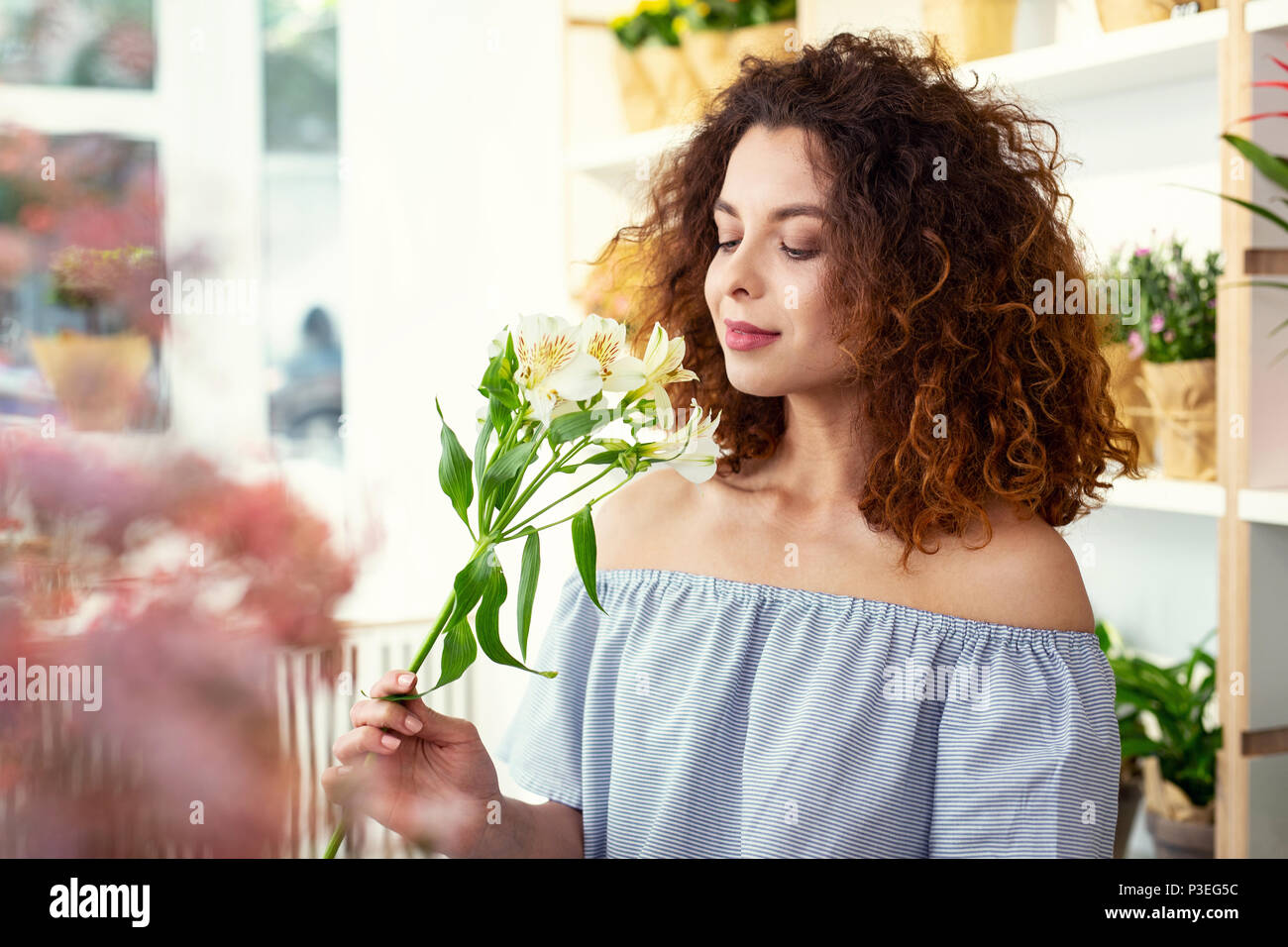 Nice young woman smelling the flower Stock Photo