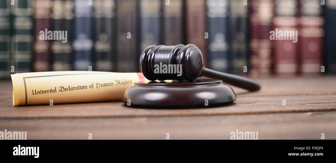 Law and Justice, Judge Gavel, Universal declaration of human rights on a wooden background, human rights concept. - Stock Image