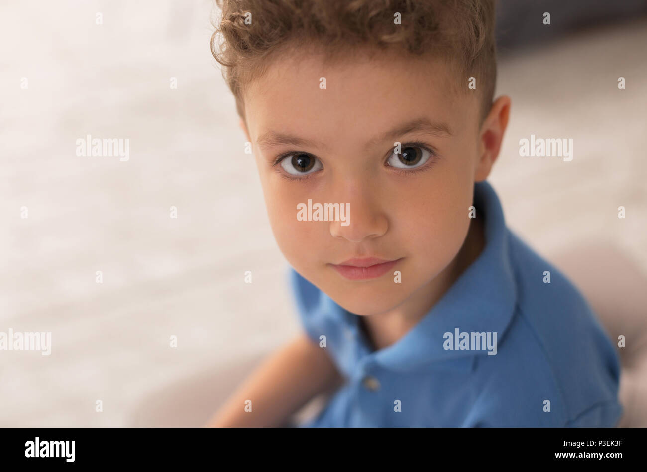 Handsome dark-eyed little boy playing at home - Stock Image