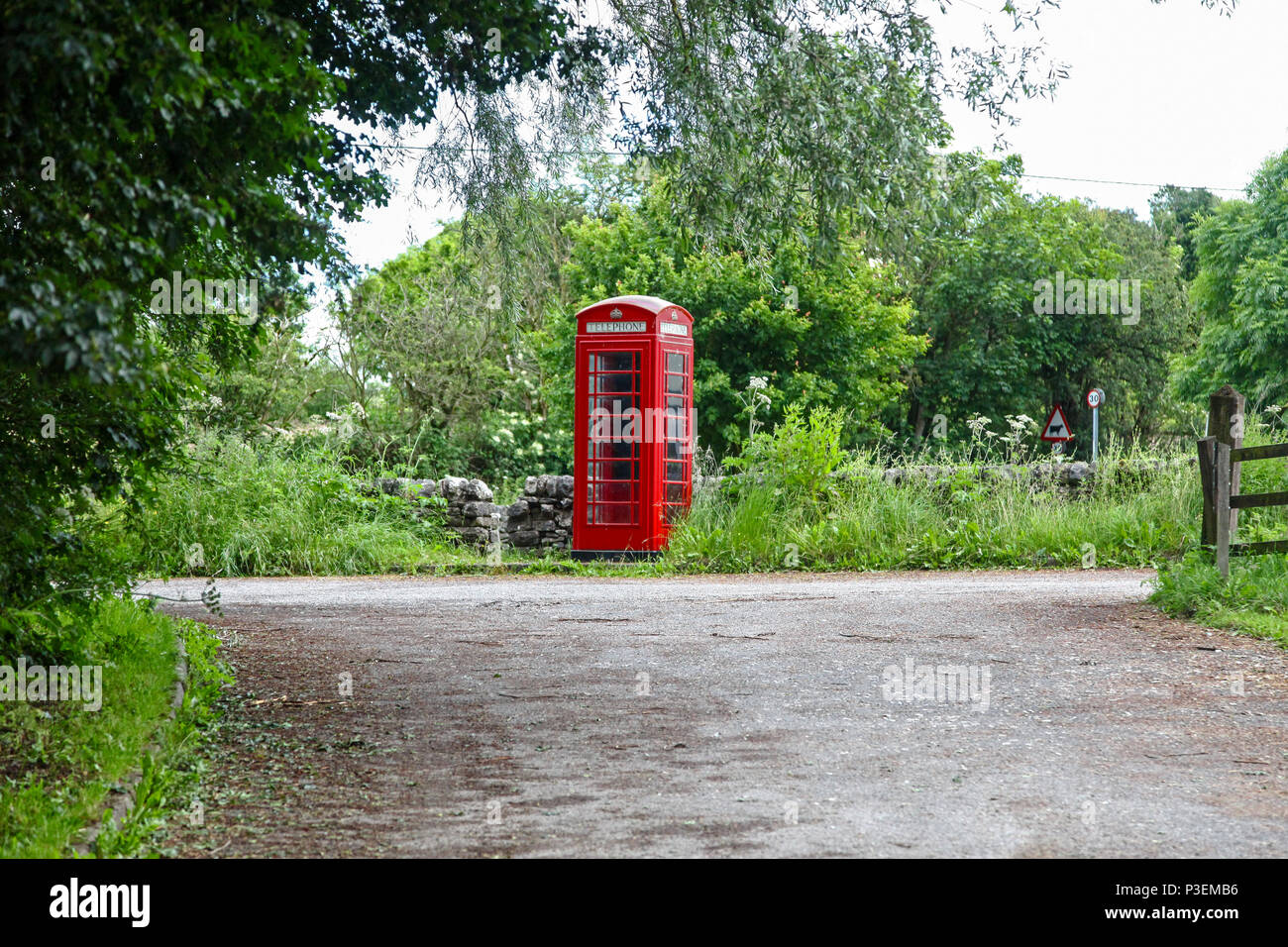 A red telephone box or kiosk at Hulme End, Manifold Valley, Staffordshire, England, UK - Stock Image