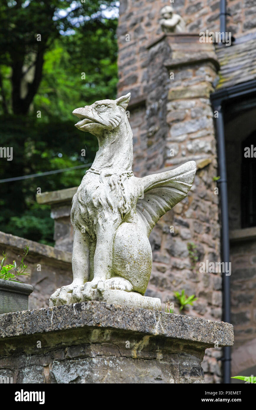A stone carved dragon or griffin sculpture or statue - Stock Image