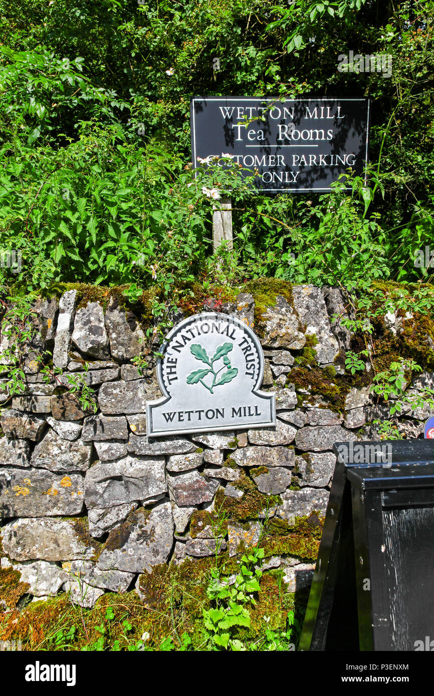 Wetton Mill Tea Rooms or café and a National Trust omega sign, Wetton Mill, Staffordshire, England, UK - Stock Image