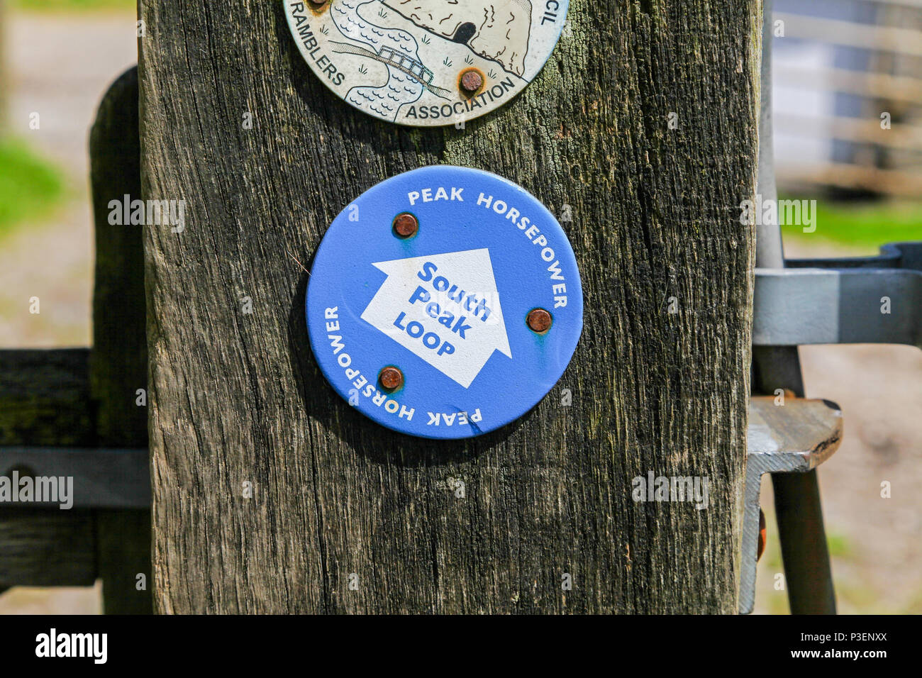 A direction sign on a wooden post for the Peak Horsepower, South Peak Loop, Staffordshire, England, UK - Stock Image