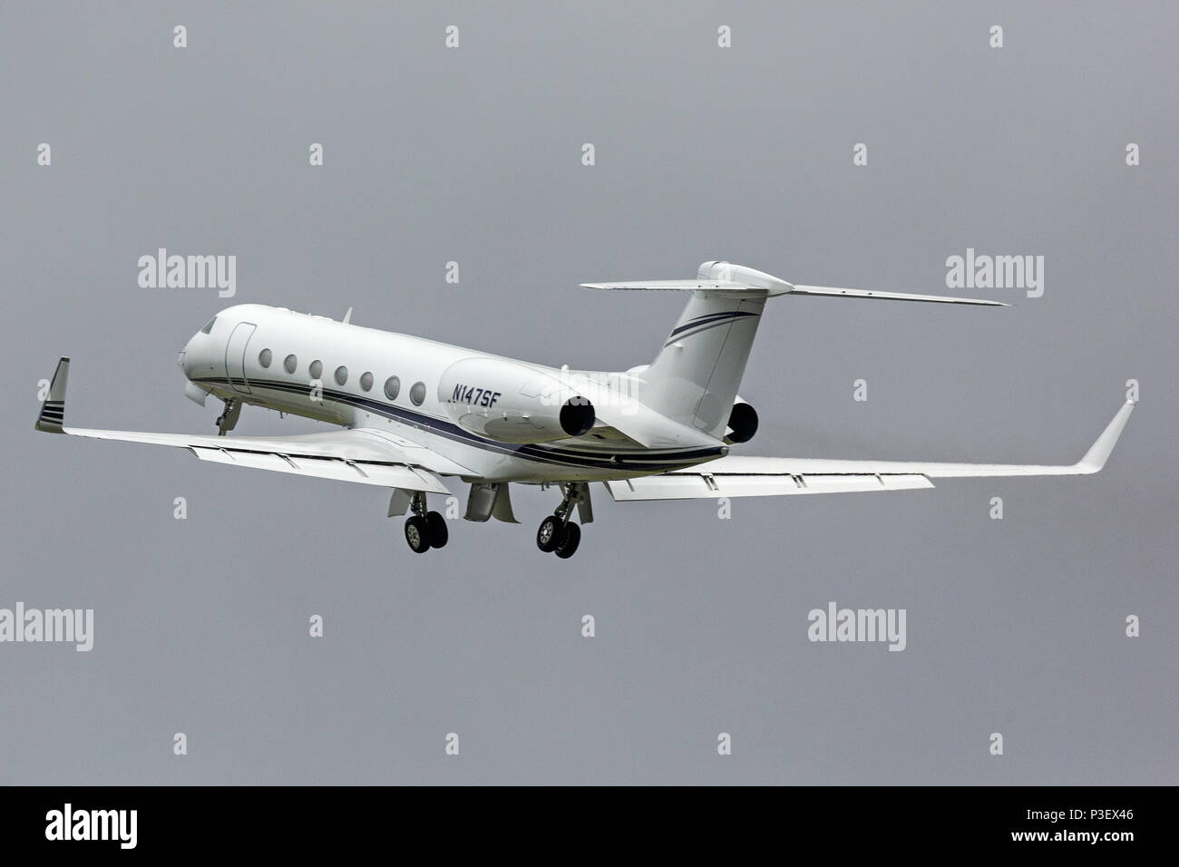 A Gulfstream Aerospace GV-SP G550 business Corporate Jet Aircraft, registered as N147SF, taking off from London Luton Airport in England. - Stock Image