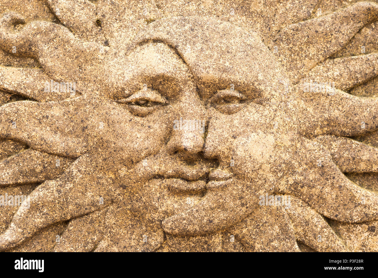 Joined Sun And Moon Faces In Stone Ornament, The Walled Garden Plant  Nursery, Benhall, Suffolk, England, UK