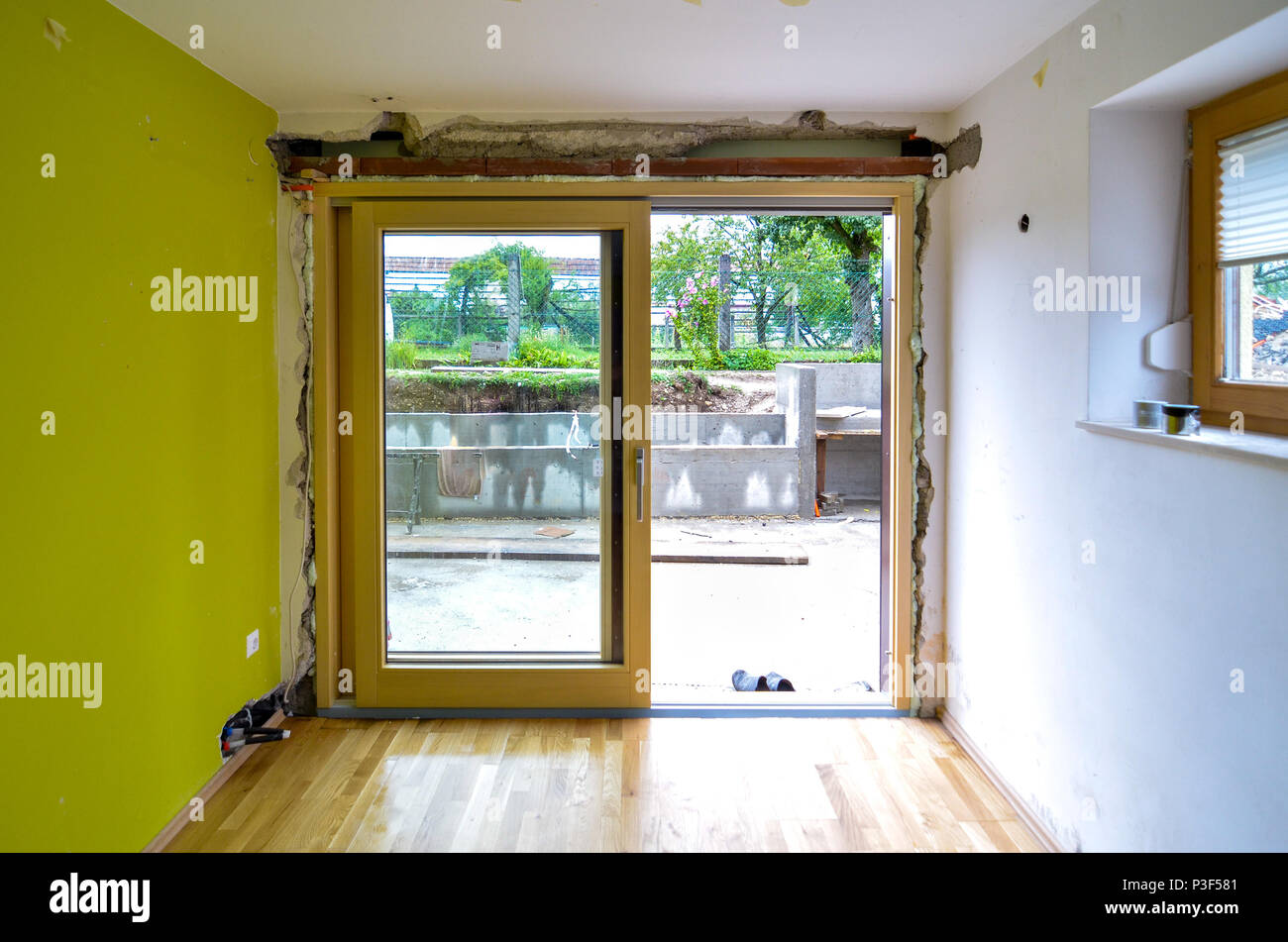 Replacing Brick Wall With Glass Sliding Door In Residential House
