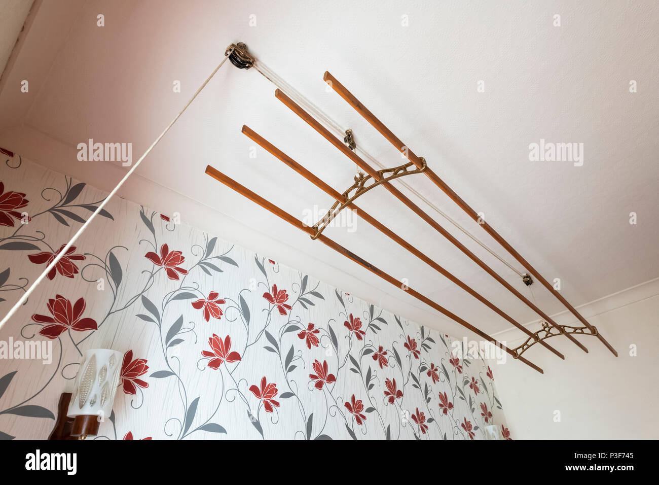 An old fashioned sheila maid (clothes airer) in a terraced house in the north of England. - Stock Image