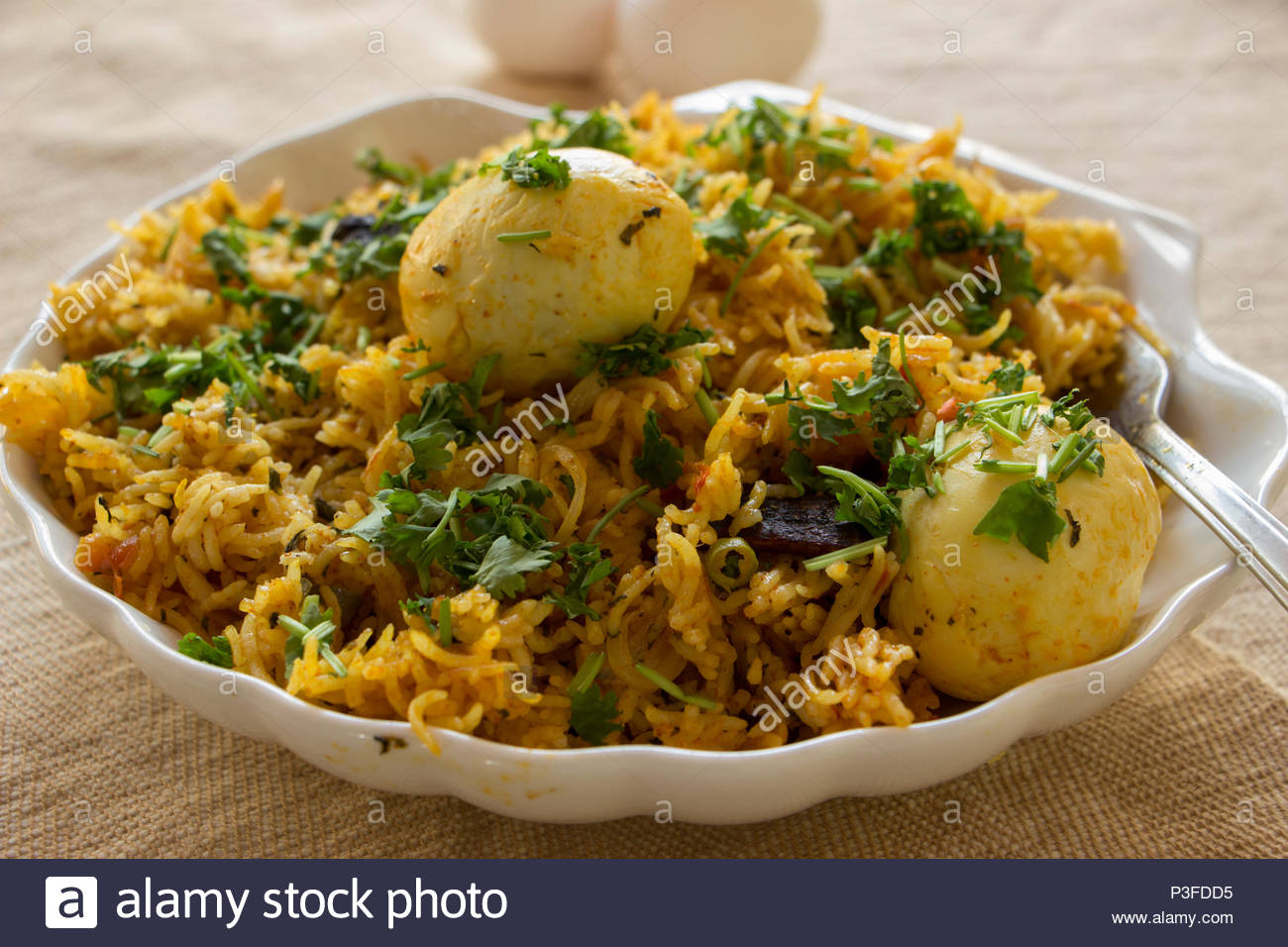 Egg biryani is a quick, flavourful and delicious rice based dish from India. - Stock Image