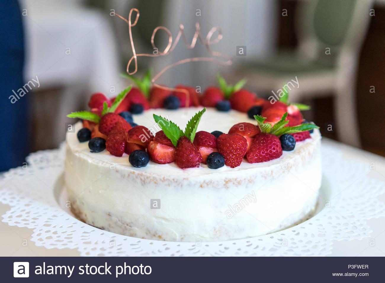 Wedding Cake with Strawberrys and Blueberrys - Stock Image