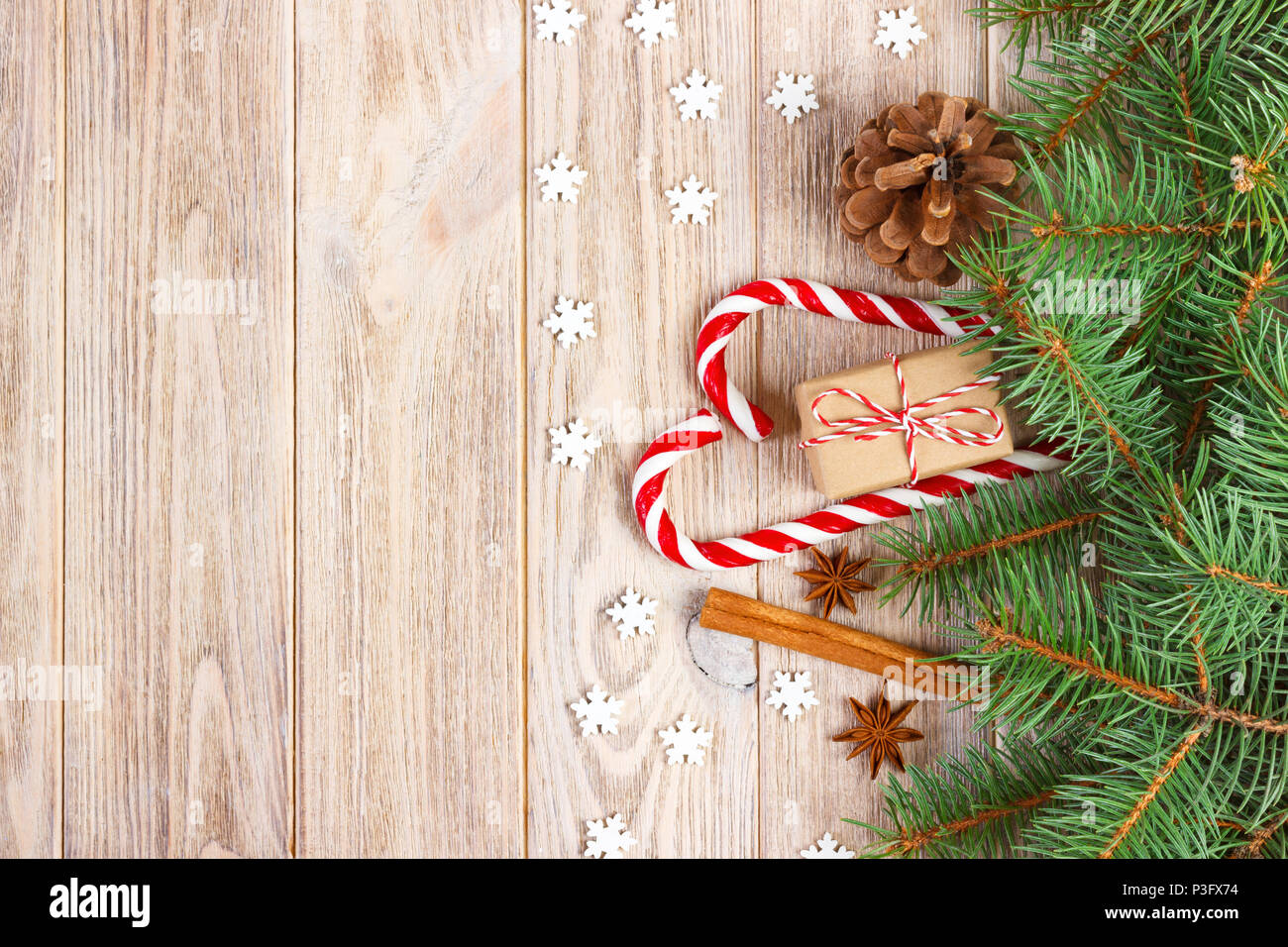 Christmas background with christmas tree branches, pine cones, candy ...