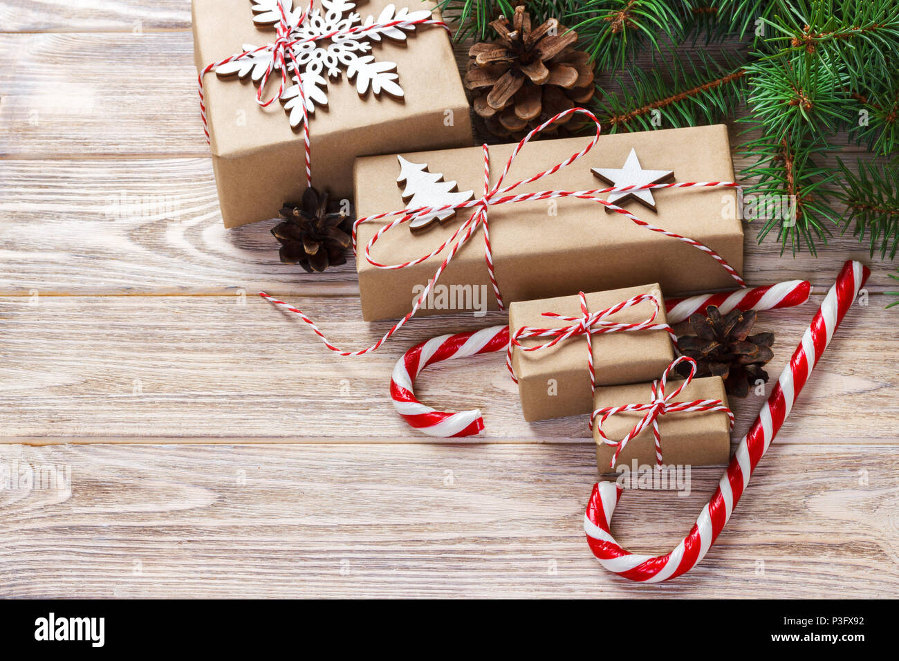 Christmas Time Concept Christmas Gifts And Traditional New Year Sweets Candy Cane On Wooden Bachground Top View Copy Space Stock Photo Alamy