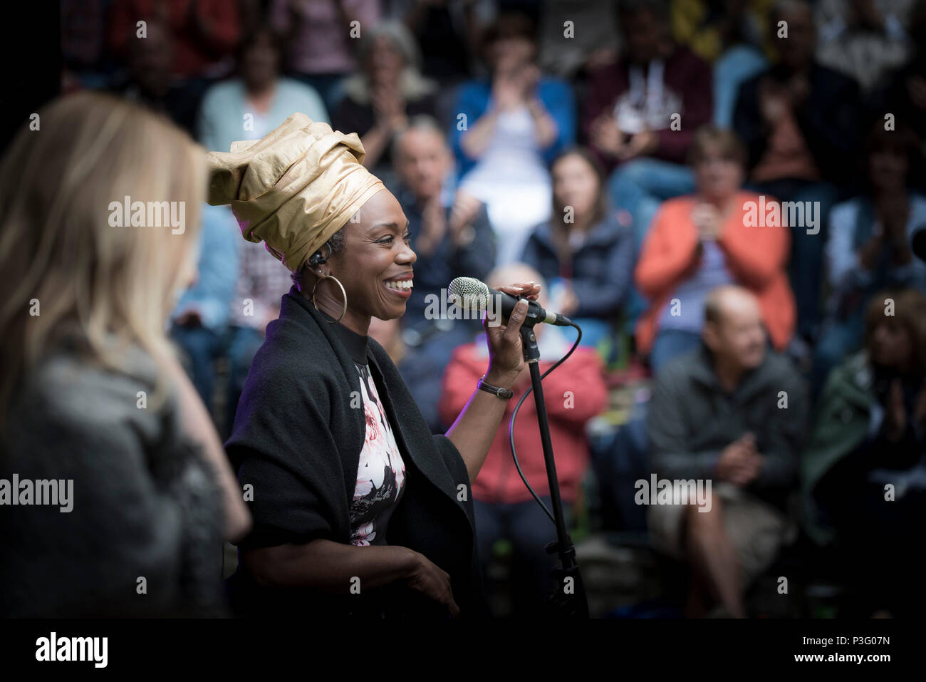 Ley Adewole lead vocalist with the The Grace Notes performing at Trebah Garden amphitheatre in Cornwall. Stock Photo
