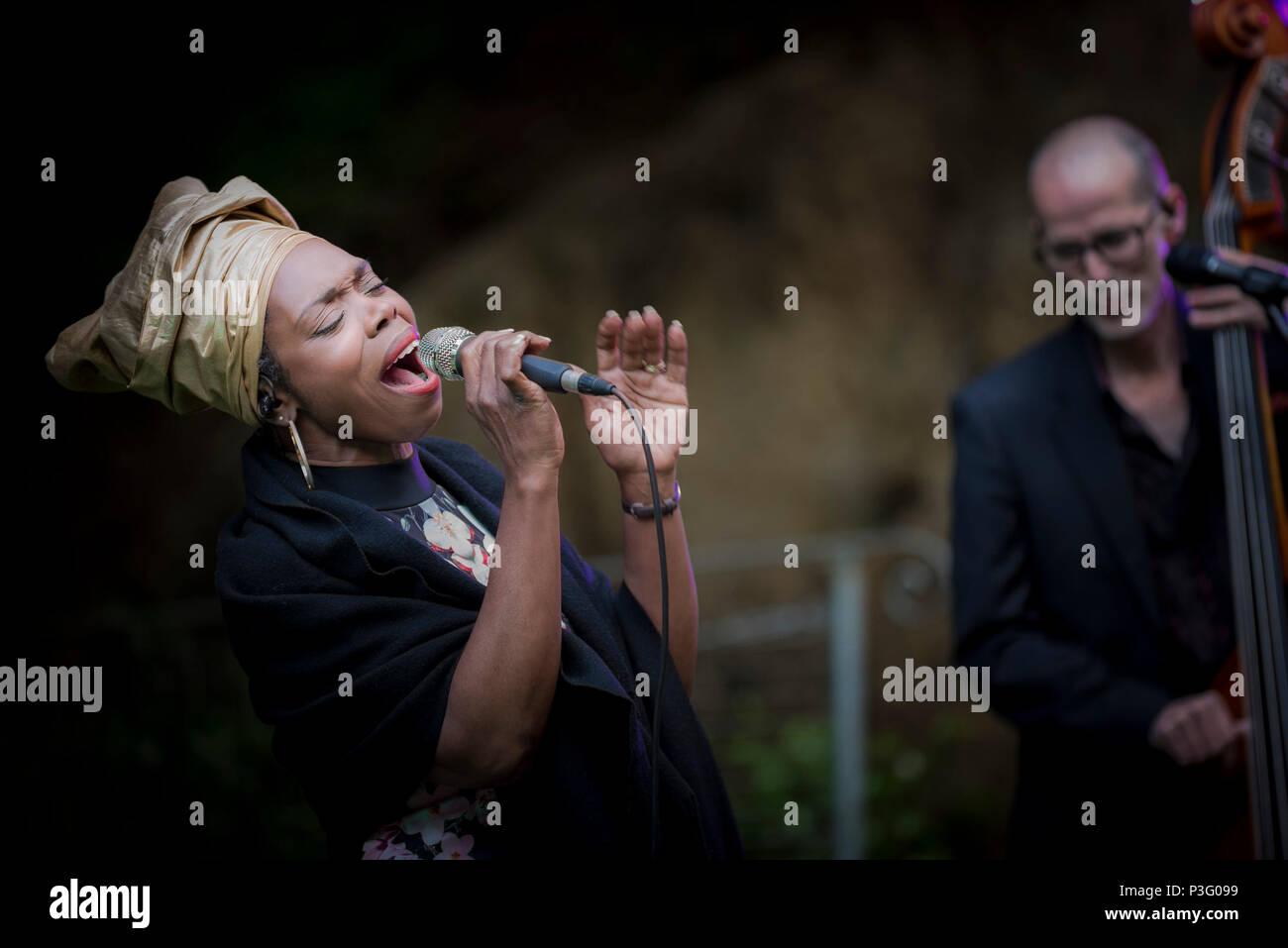 Ley Adewole lead vocalist of The Grace Notes performing at Trebah Garden amphitheatre in Cornwall. - Stock Image