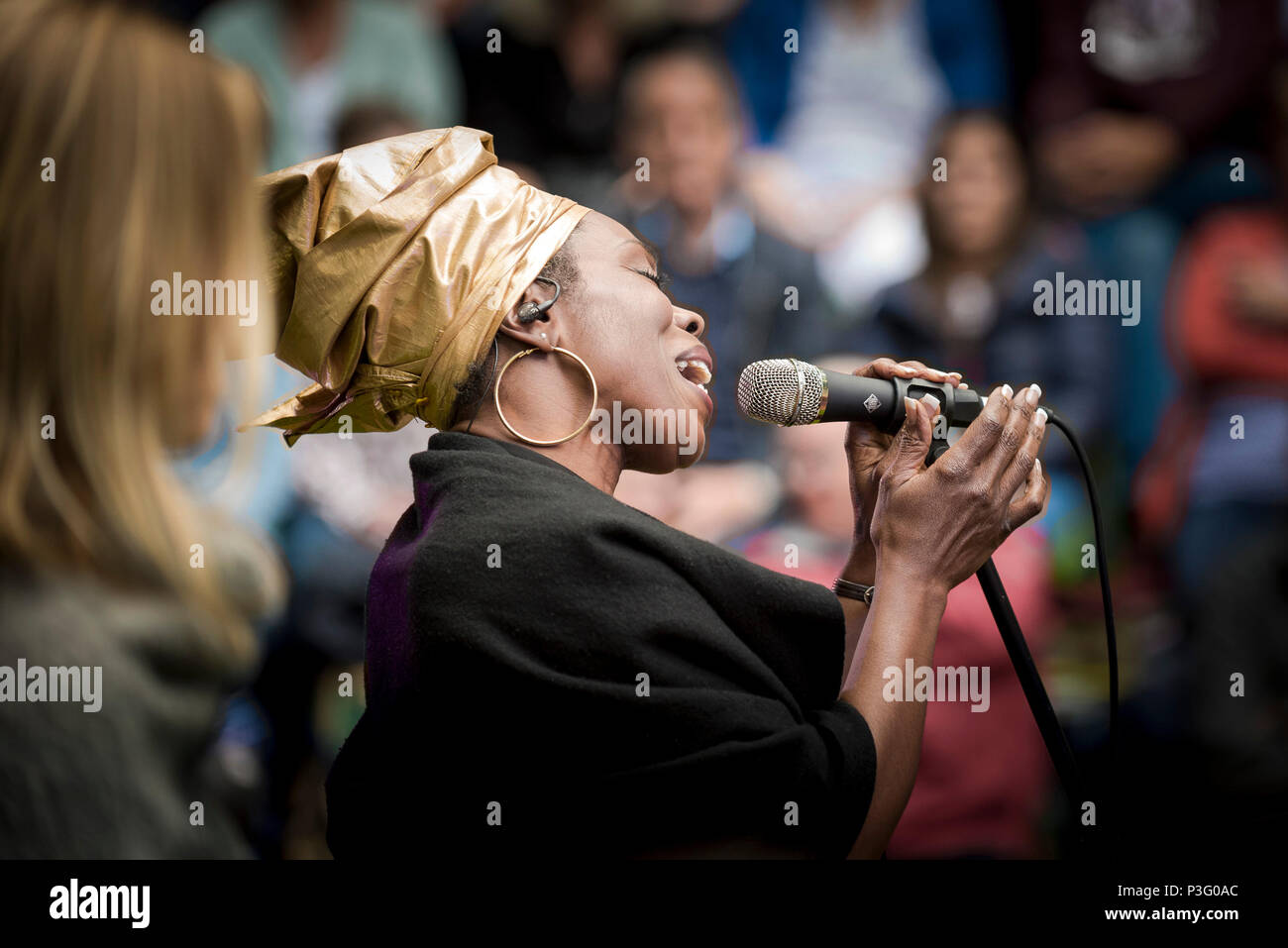 Ley Adewole lead singer of The Grace Notes performing at Trebah Garden amphitheatre in Cornwall. - Stock Image