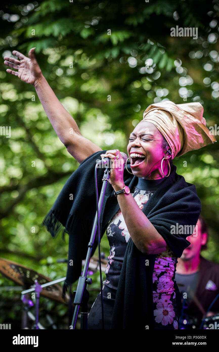 Ley Adewole lead singer with the The Grace Notes performing at Trebah Garden amphitheatre in Cornwall. - Stock Image