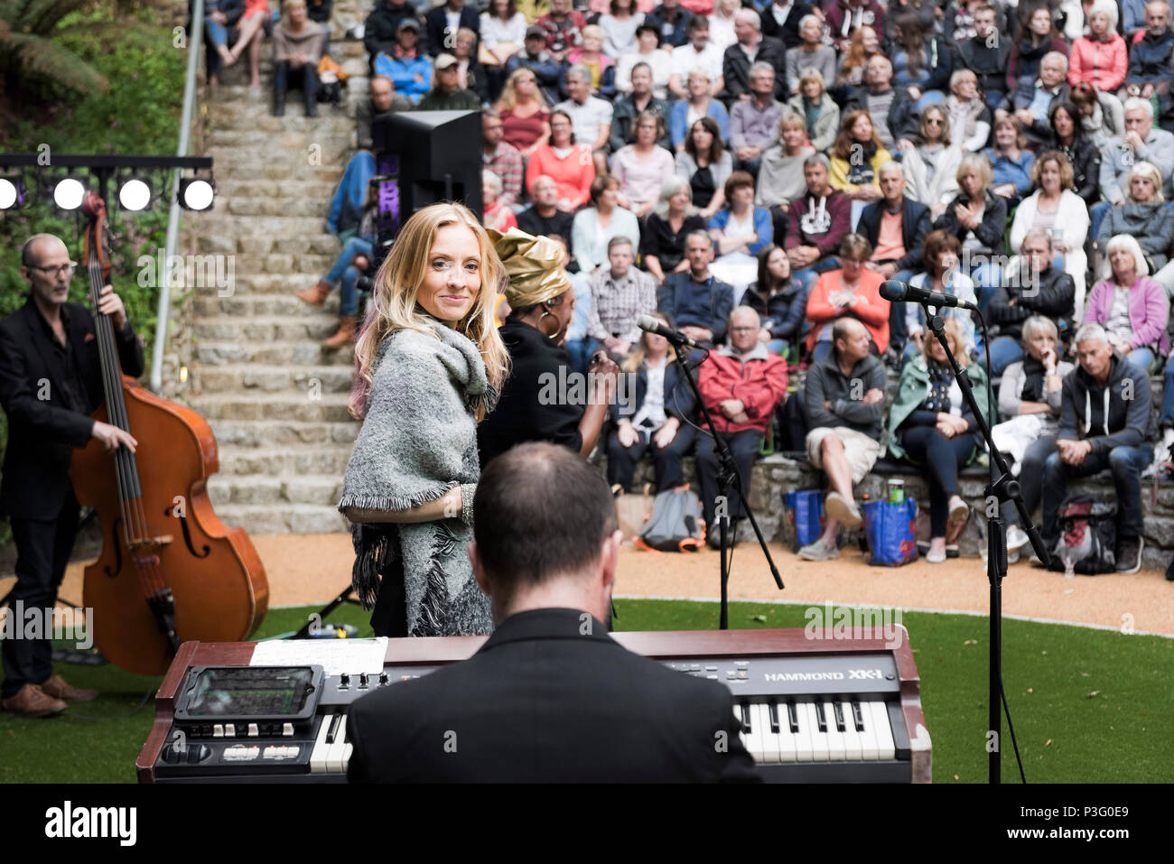 The Grace Notes performing at Trebah Garden amphitheatre in Cornwall. - Stock Image