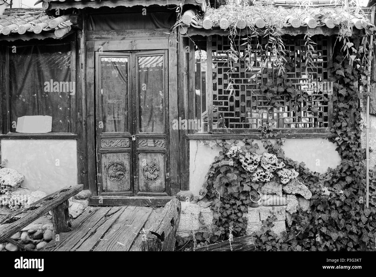 Vintage Home Entrance (Old Town of Lijiang, Yunnan, China) - Stock Image
