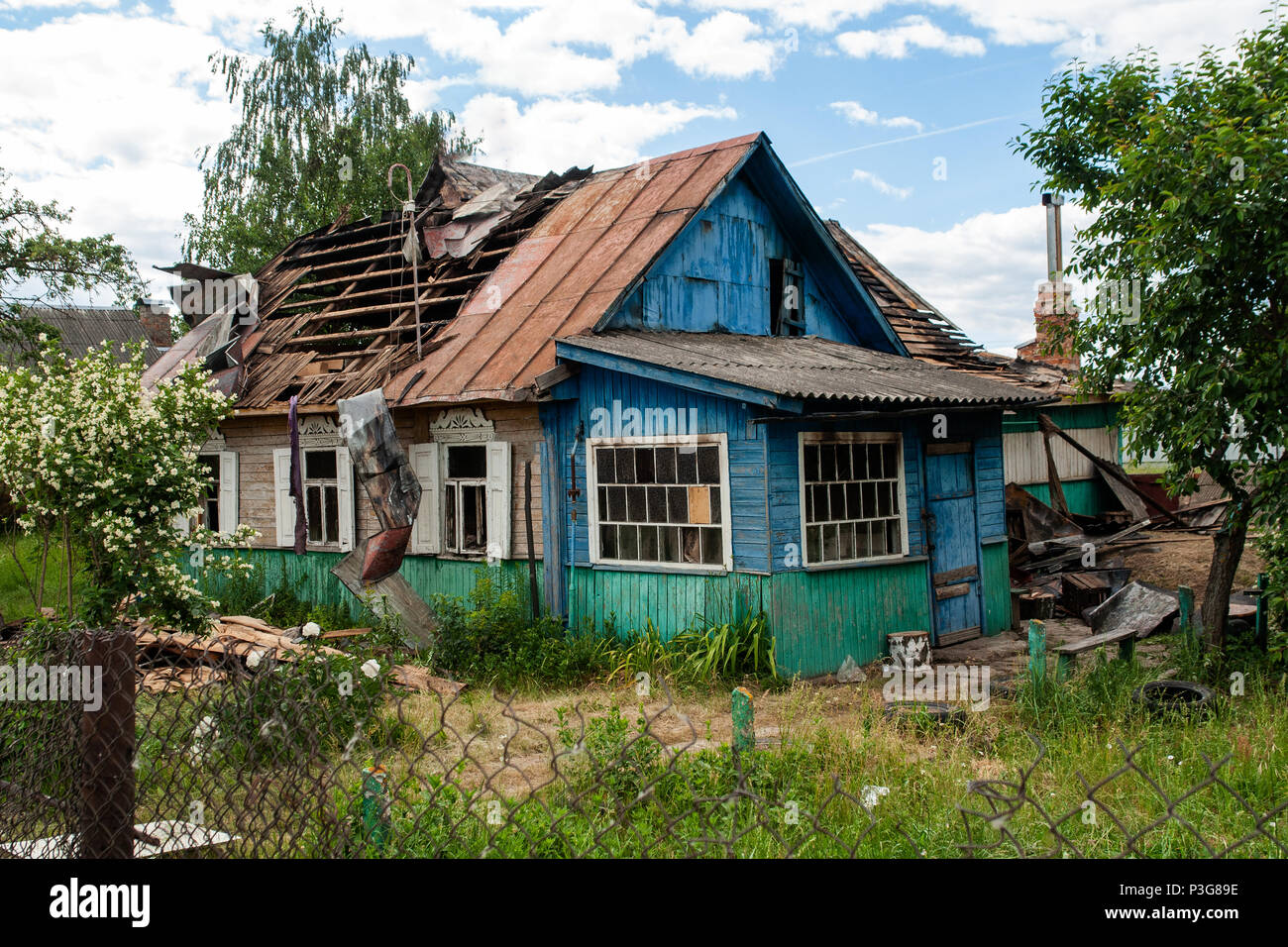 a house with a broken roof - Stock Image