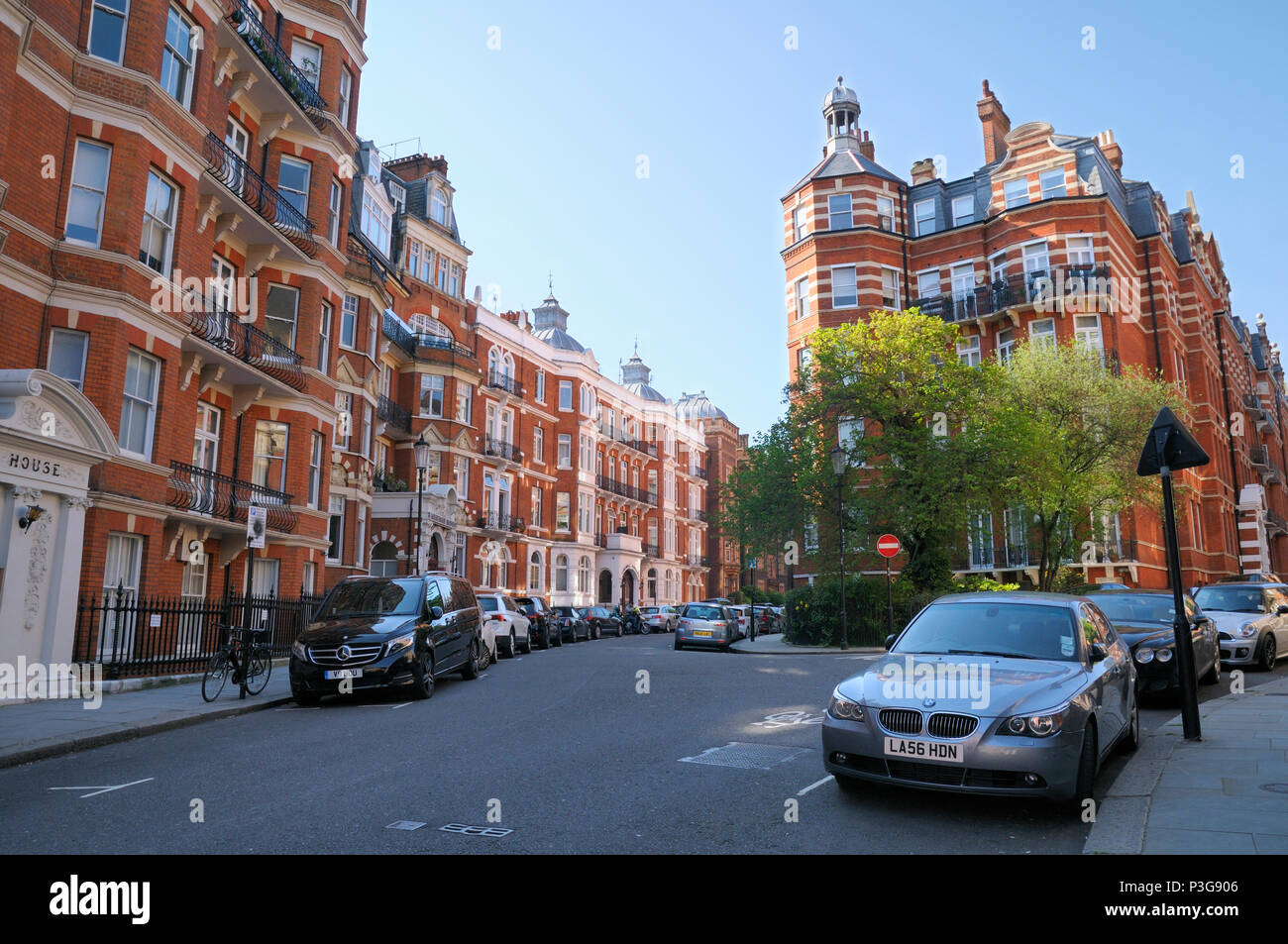 Elegant red brick mansion blocks in Kensington Court, Royal Borough of Kensington and Chelsea, London W8, England, UK - Stock Image