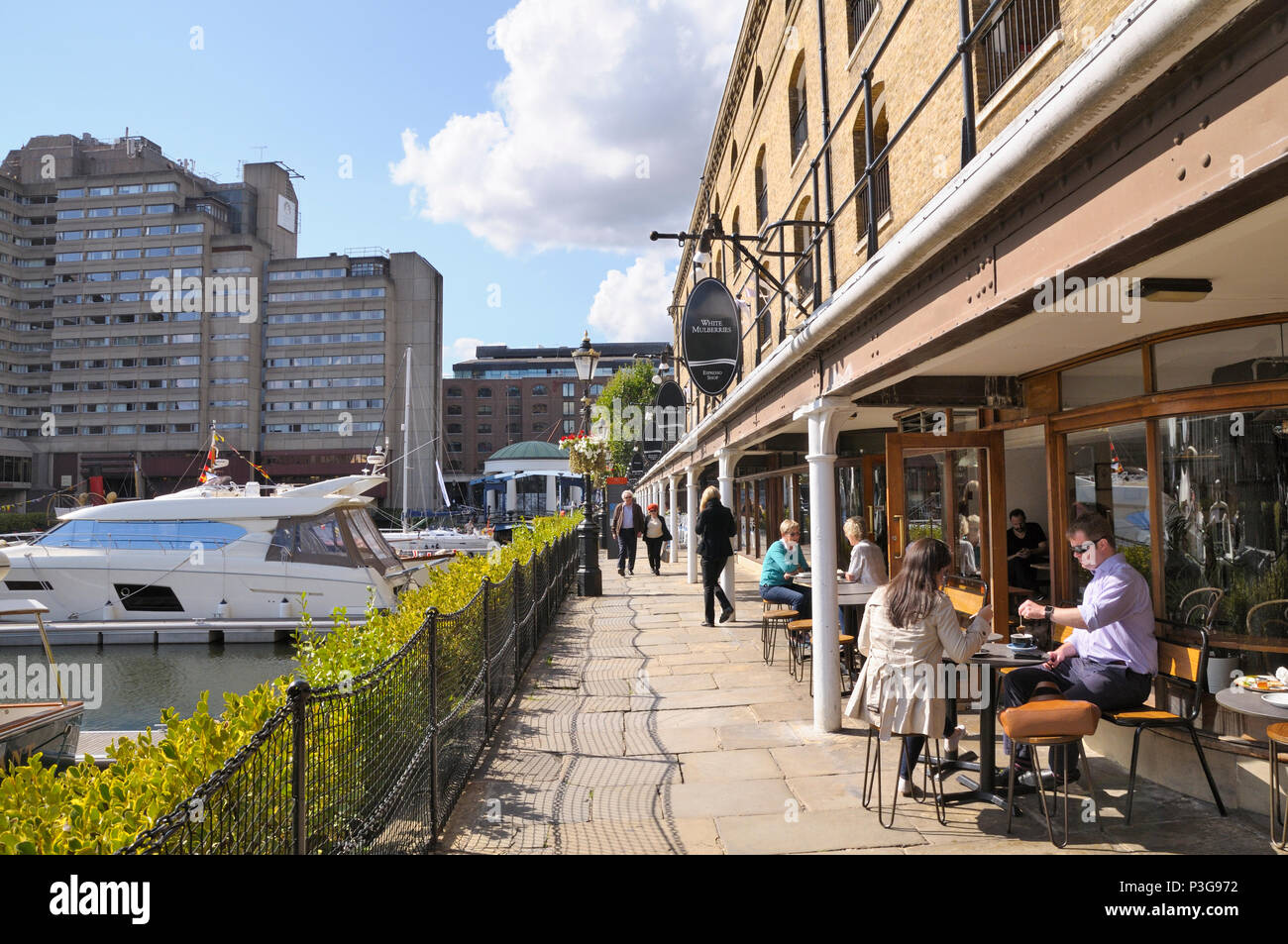 Cafés and restaurants along the marina at St Katharine Docks, Tower Hamlets, London, England, UK - Stock Image
