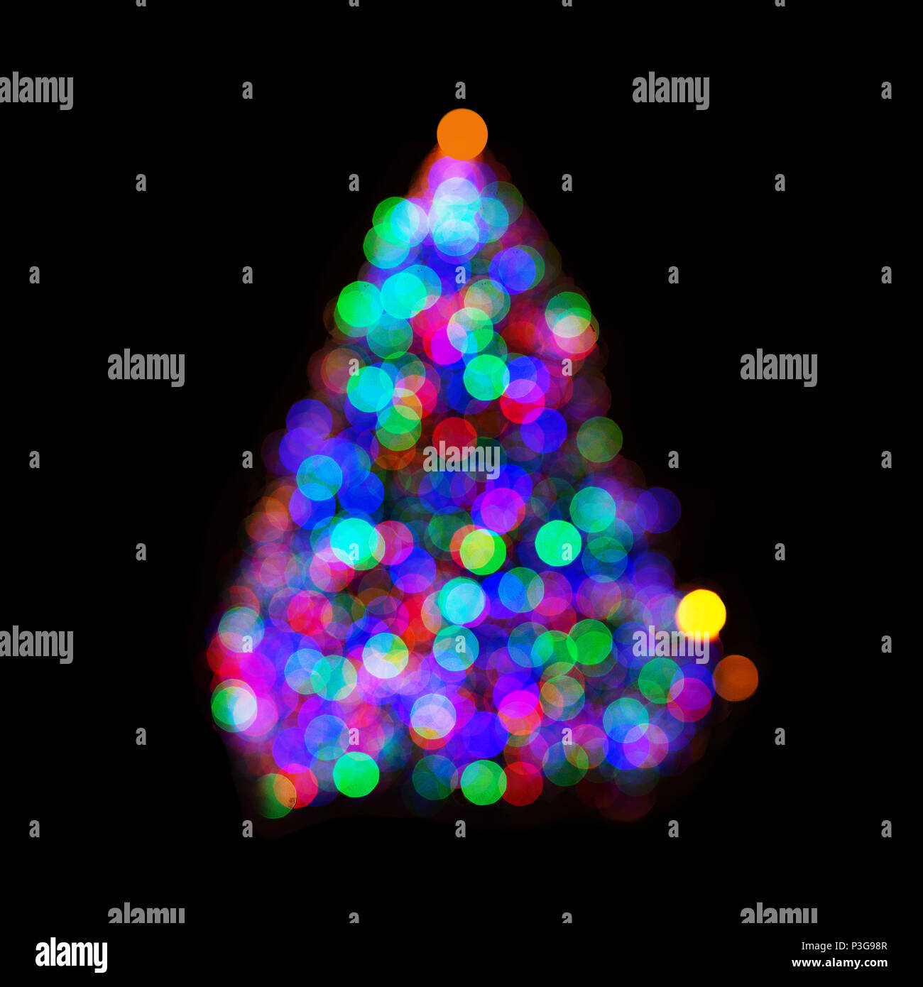 multicolored christmas tree lights in bokeh isolated on black