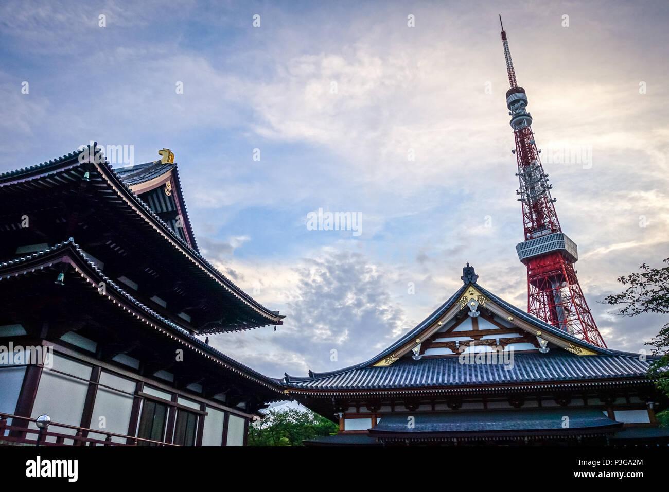 Zojo-ji temple and Tokyo tower at sunset, Japan - Stock Image