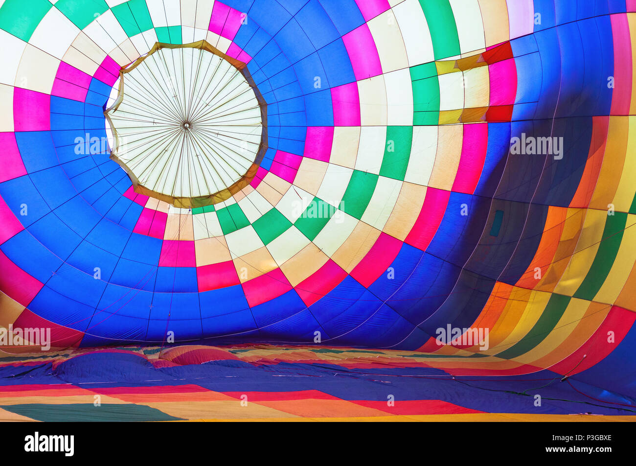 Bright abstract multicolored background, hot air balloon view from inside - Stock Image