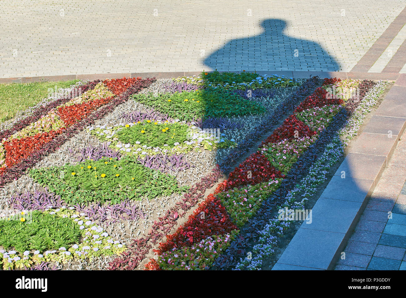 Shadow of the monument to Taras Shevchenko, Ukrainian poet, writer, artist, public and political figure, as well as folklorist and ethnographer on a sunny morning in Kyiv, Ukraine - Stock Image