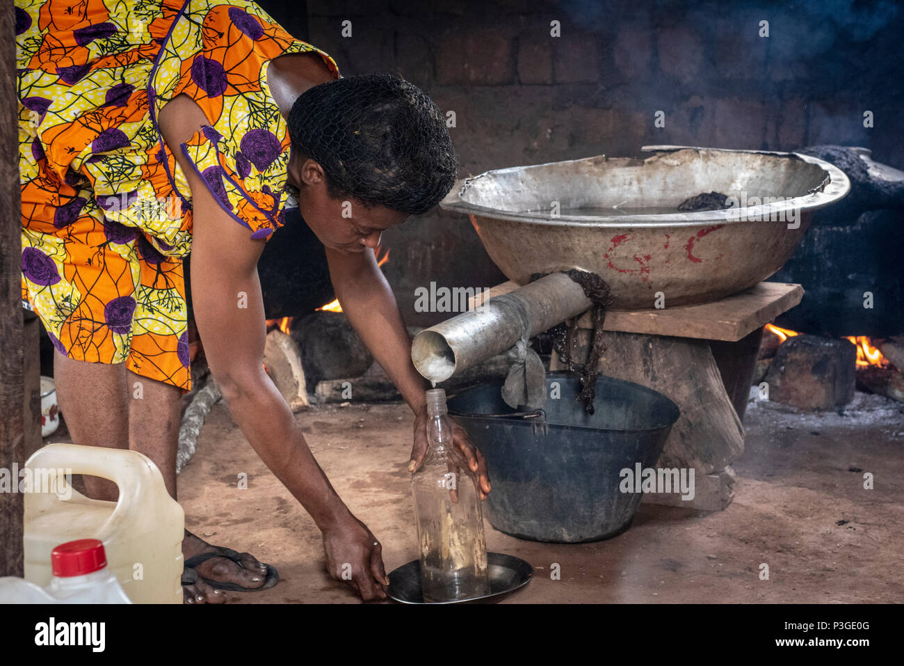 making local moonshine or liquor with homemade still Awae, Cameroon, - Stock Image